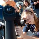 Kaelynn Rose, a sophmore geology major, adjusts the telescope during the Transit of Venus across the Sun on Tuesday June 5, 2012 at UC Davis.