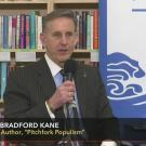 Photo of Bradford Kane on C-SPAN Book TV program, addressing audience at a bookstore book talk.