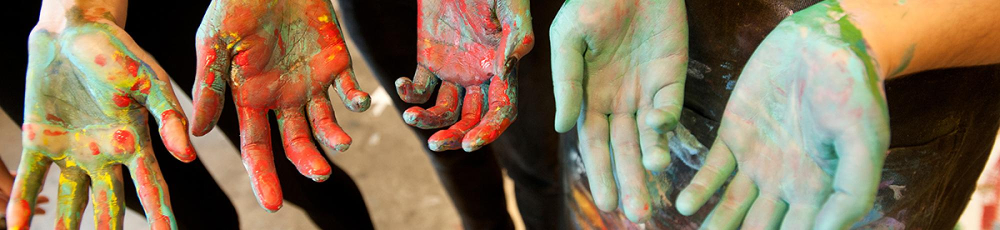 Photo: student hands covered in paint