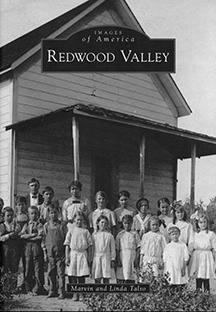 Book cover showing historic photo of school children and teachers