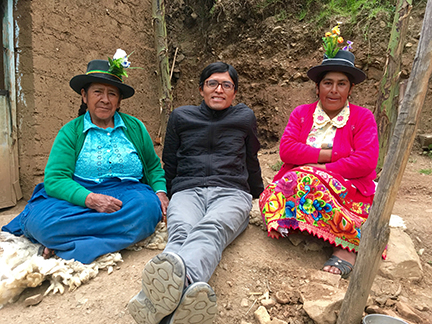 UC Davis history grad student Renzo Aroni with two village women in traditional dress