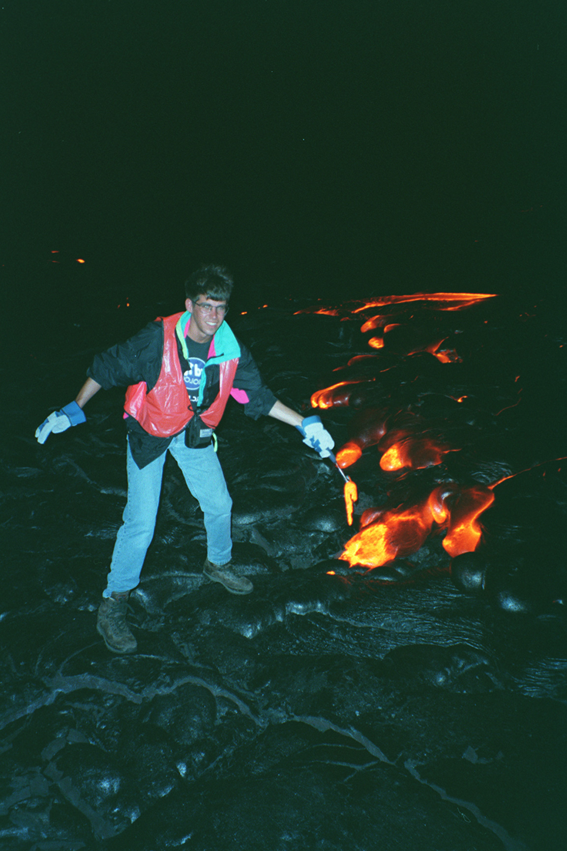 Mike Poland sampling lava