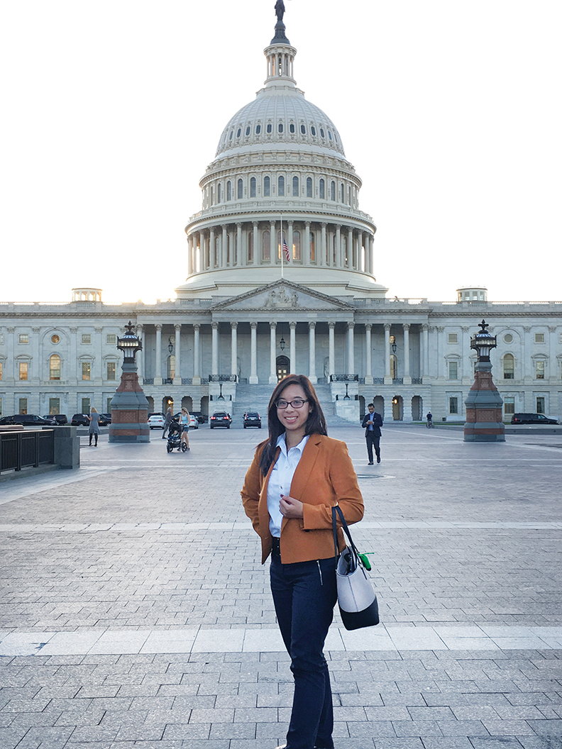 Photo of UC Davis student in front of U.S. capitol building