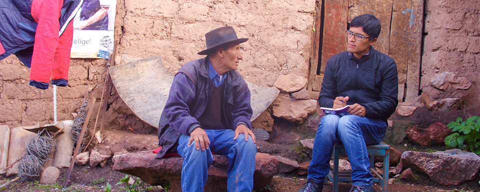 Photo of UC Davis history grad student Renzo Aroni interviewing a villager in Peru.