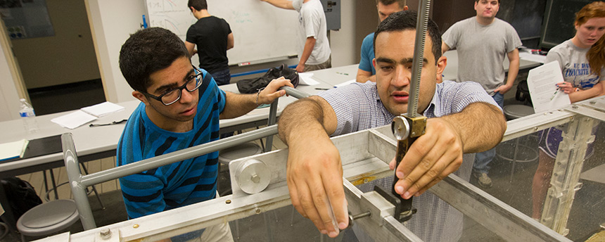 UC Davis civil and environmental engineering graduate student Kaveh Zamani, right, teaches undergraduates in the hydrophonics lab in Bainer Hall. He was also a winner of the 2014 Outstanding Graduate Student Teaching Award. (Karin Higgins/UC Davis)