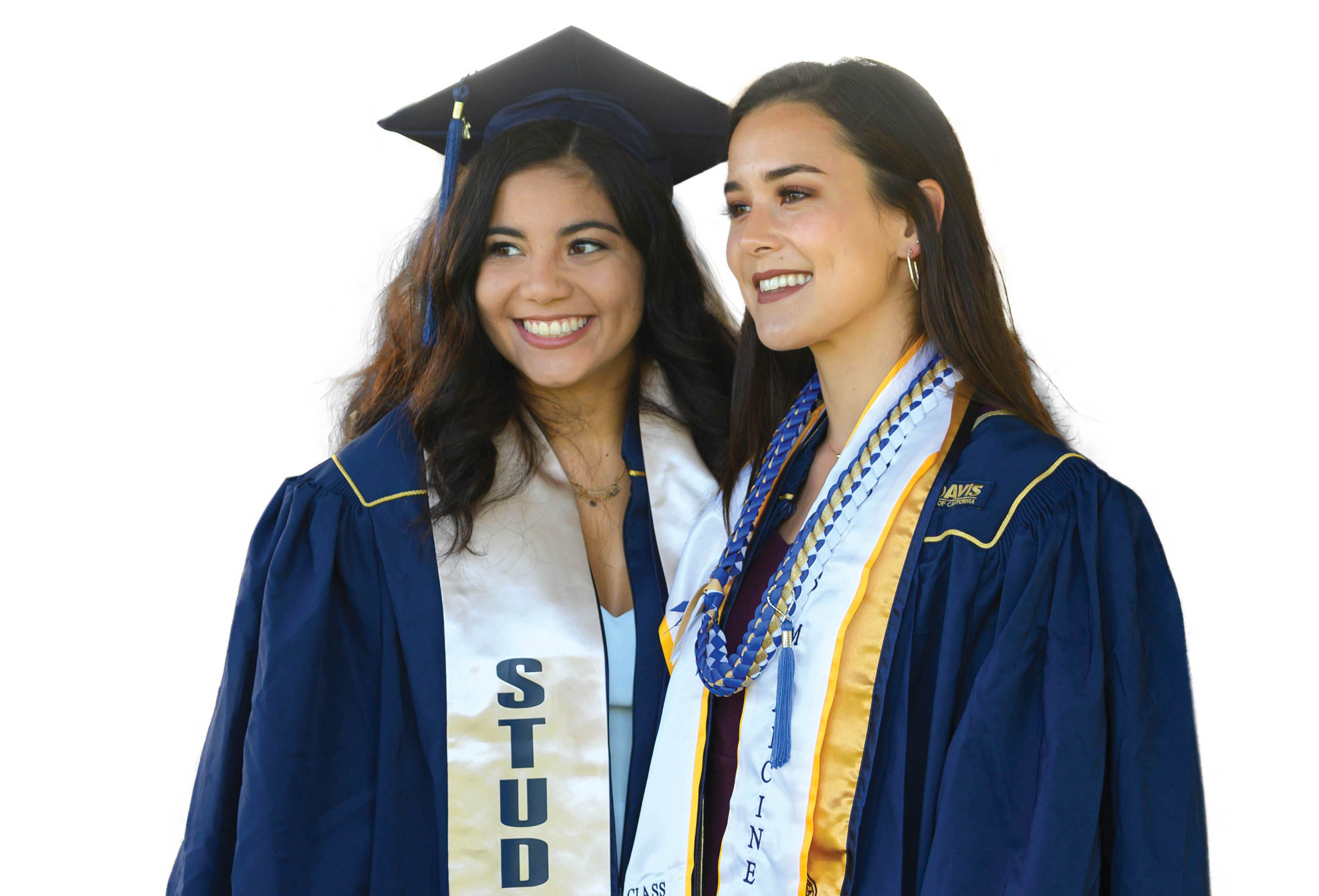 photo of two female graduating students