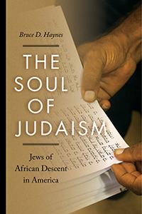 Book cover with image of African American hands holding pages of Hebrew text