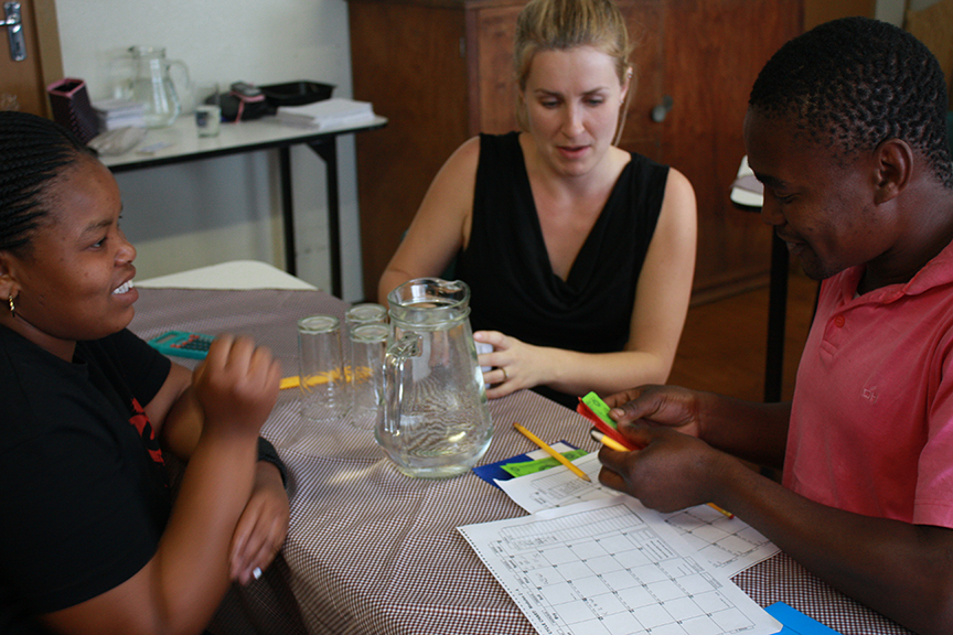 UC Davis sociology student Heather Van Buskirk with participants in a business training workshop in South Africa