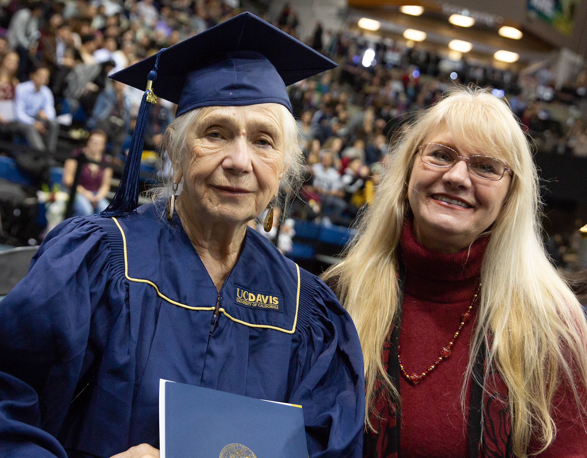 Marianna Daniel in cap and gown with her daughter at UC Davis commencement