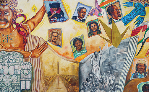 Photo of mural with images from Chicano, African American, Asian American and Native American histories and cultures