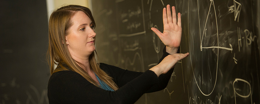 Rachel Houtz, a doctoral candidate in physics at UC Davis, shown here teaching a class, also earned a Master of Science in physics here. (UC Davis)