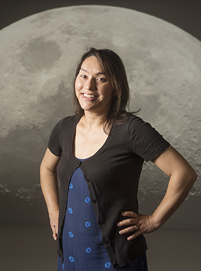 Photo of UC Davis professor Sarah Stewart in front of image of the moon