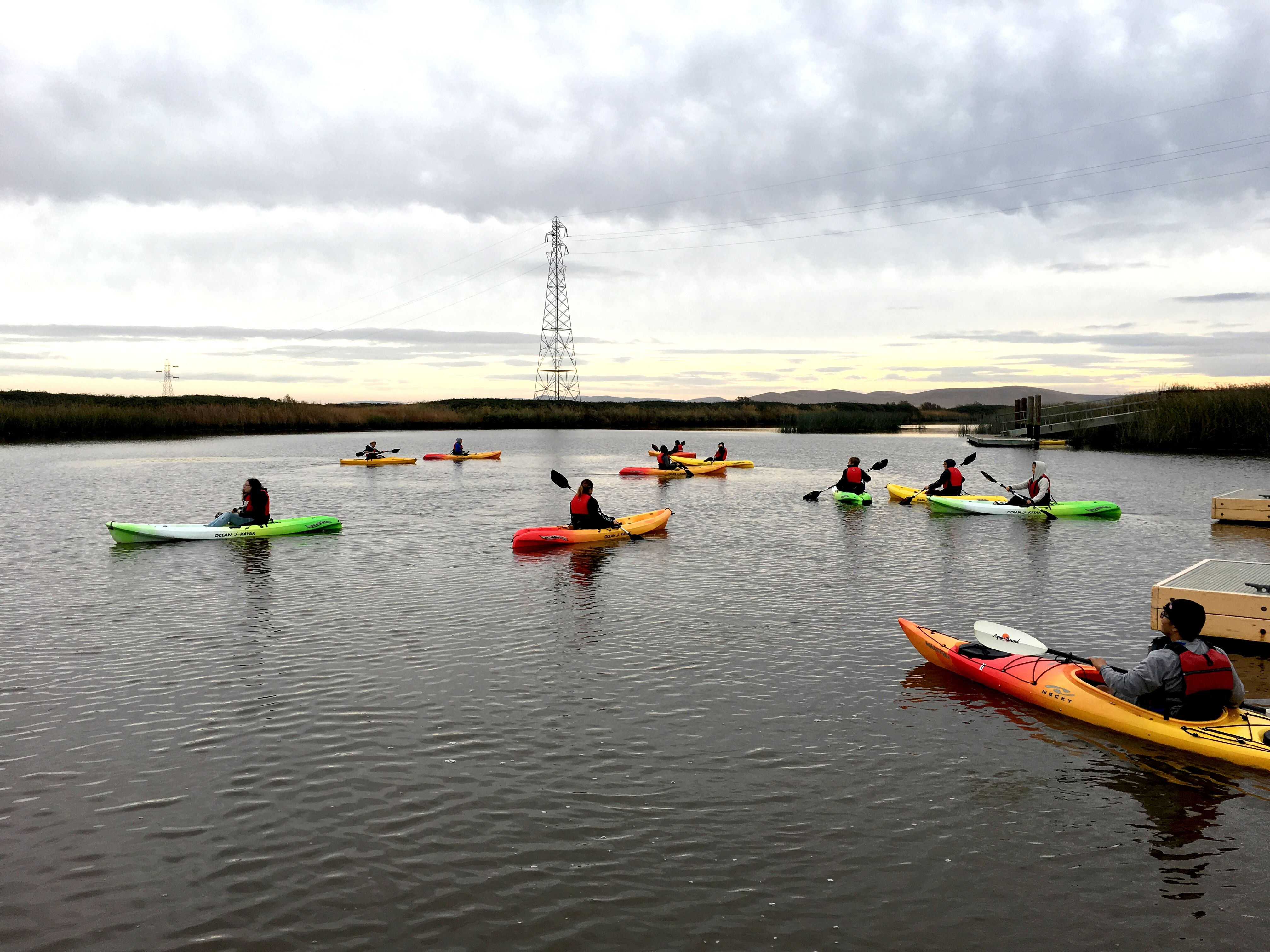 students study in kayaks