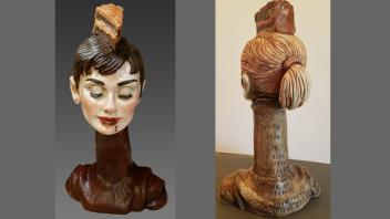 "Ceramic bush of Audrey Hepburn with slice on cake on her head and quote on back: ""Let's face it, a nice creamy chocolate cake does a lot for a lot of people; it does for me."""
