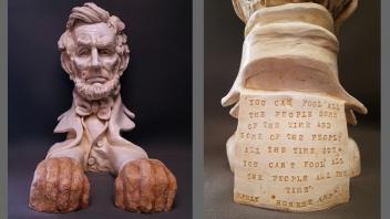 Abraham Lincoln sculpture, front and back, with Lincoln quote about fooling some of the people some of the time.