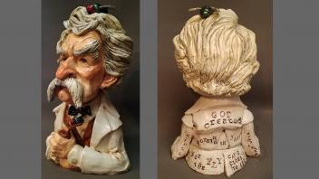 Sculpture of Mark Twain with a fly on his head and quote on back: God created nothing in vain, but the fly came close to it.