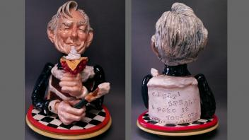 Front and back views of sculpture of Wayne Thiebaud with a cake torso and holding a slice of pie and a paintbrush. On back reads a quote: Create, steal and make it your own!""