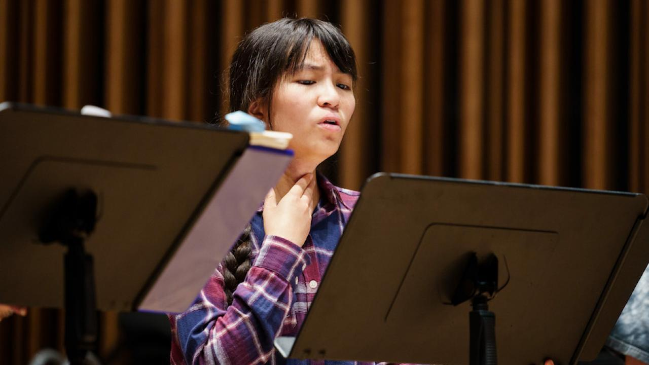 picture of Mira Huang at music stand singing UC Davis
