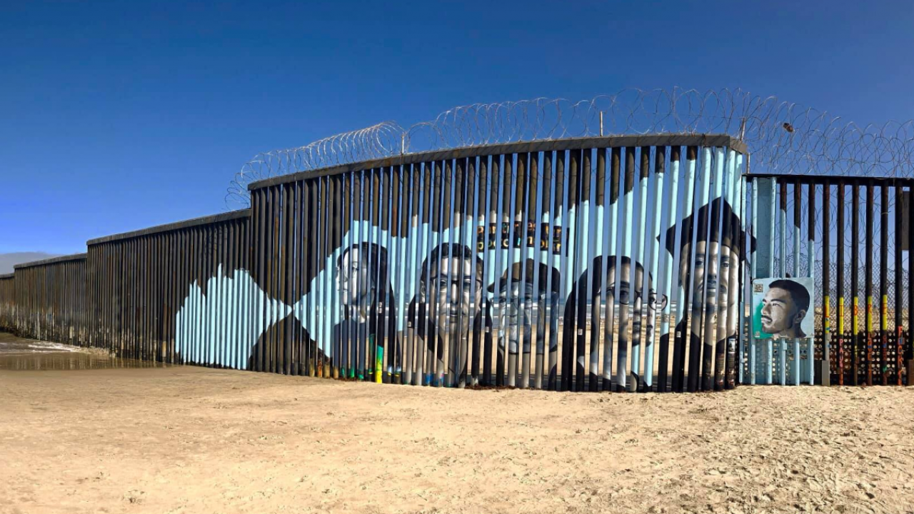 Mexico/U.S. border wall with mural organized by UC Davis student