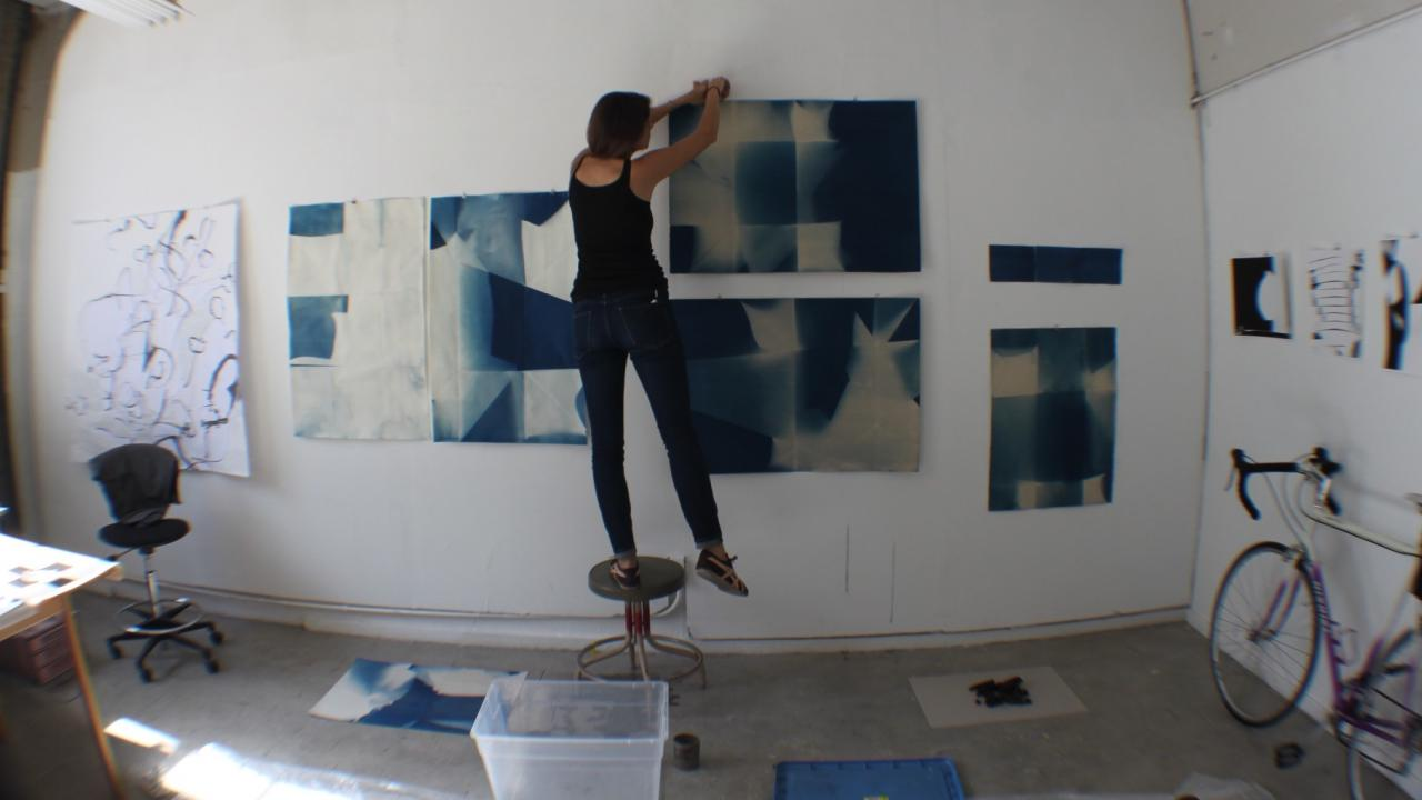 Image of student installing master's degree show at Manetti Shrem Museum