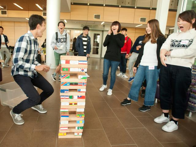students playing game in student center