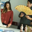 Senior communication major Karice Hui, left, and senior economics major Yongcong Cen view Asian art and cultural items at a recent East Asian studies gathering encouraging students of all majors to learn about the program and its education. (Karin Higgins/UC Davis)