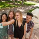 "These students from the College of Letters and Science include, from left, Cindy Suzuki, a design major; Hailey Jenkins, a communication major; Lindsey O'Tousa, a psychology major; and Miguel Bagsit, a communication major. They posed at a popular selfie site with the ""Eye on Mrak (Fatal Laff)"" Egghead. (Gregory Urquiaga/UC Davis)"