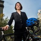 Alumna Sydney Vergis, a double major in economics and environmental policy, analysis and planning, often rides her bike from Davis to Sacramento where she is the acting legislative director for the California Air Resources Board. (Karin Higgins/UC Davis)