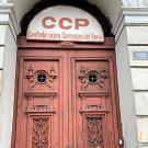 Photo of doorway and sign that reads CCP and Confederación Campesina del Perú
