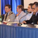 Photo: panelists at conference