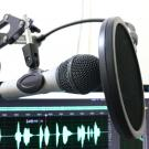 Photo of microphone and computer