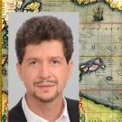 Photo of UC Davis historian Andres Resendez set over an historic map of Magellan's voyage