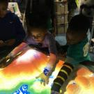 Children play with the UC Davis AR Sandbox