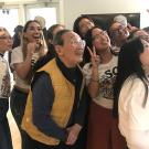 Isao Fujimoto takes a selfie with students at a recent event honoring him.
