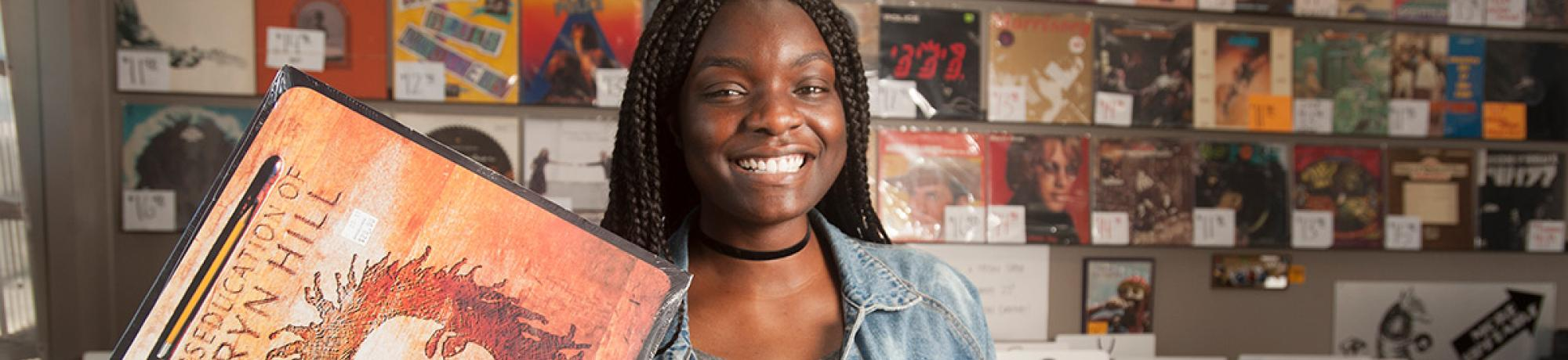 Taking a gap year after graduation can help decide your future. McNair scholar and Fulbright award winner Amanda Eke '17, with bachelor's degree in gender, sexuality and women's studies, is spending this year using hip hop lyrics to teach English in Malta. (Gregory Urquiaga/UC Davis)