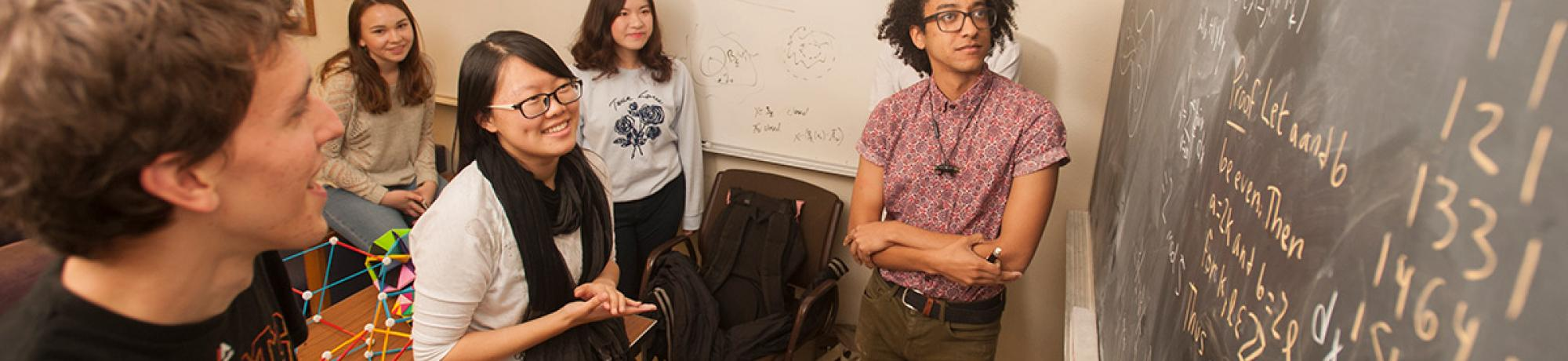 Students talk about working out problems in the math lounge including, from left, David Williamson, Alina Gataullina, Chutong Wu, Cathy Jia and Zachary Spaulding, all math majors. (Gregory Urquiaga/UC Davis)